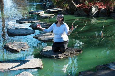 meditating at a pond