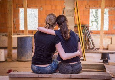Close friends sitting in embrace