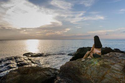 heartbroken girl on the rocks